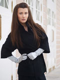Looking girl in a coat Royalty Free Stock Images
