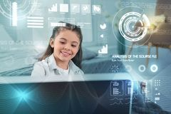 Smiling child looking at the big computer and smiling happily Stock Image