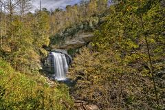 Looking Glass Falls Waterfall. Looking Glass Falls is a scenic 60 foot waterfall in western North Carolina. Seen here in autumn stock photos