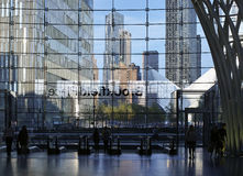 Looking through glass wall of Brookfield Place towards One WTC a. Looking from inside dark Brookfield Place through glass wall towards One WTC and Oculus PATH Stock Images
