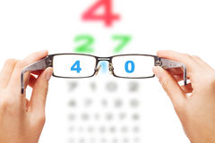 Looking through the glasses at eye chart Royalty Free Stock Photos