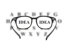Looking through glasses at idea text Stock Photo