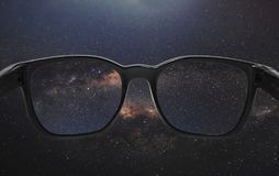 Looking through glasses on the sky full of star in starry night stock images