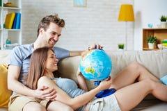 Looking at globe Royalty Free Stock Photo