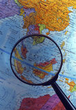 Looking at globe using magnifying glass (South East Asian Region) Stock Photography