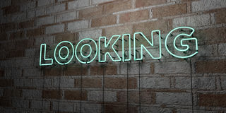 LOOKING - Glowing Neon Sign on stonework wall - 3D rendered royalty free stock illustration Royalty Free Stock Image