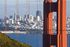Looking through the Golden Gate. The Golden Gate bridge frames a view of San Francisco in the distance Stock Image