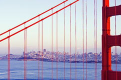 Looking through the Golden Gate. The Golden Gate bridge frames a view of San Francisco in the distance Royalty Free Stock Photos
