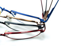 Looking good; seeing better. Four different colored glasses or spectacles in a row Royalty Free Stock Image