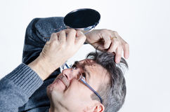 Looking for gray hair Royalty Free Stock Images