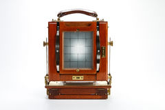Looking through the ground glass of a wooden view camera. Stock Photos