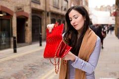Looking in handbag Stock Photos