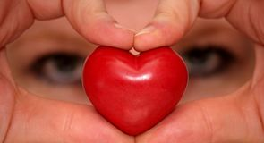 Looking through hands forming heart. Looking through hands forming a heart Royalty Free Stock Images