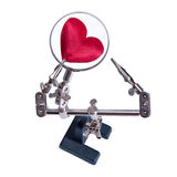 Looking a heart through a magnifying glass. Looking a red heart through a magnifying glass Royalty Free Stock Images