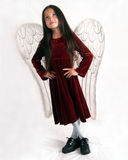 Looking heavenly. Young girl in angel wings looking upward Stock Photography