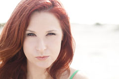 Looking into her eyes. A close up portrait of a beautiful redhead Royalty Free Stock Photography