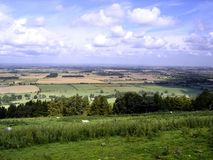Looking from hill over flat fields in England Stock Photos