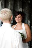 Looking at his bride. Young man is looking at his bride Royalty Free Stock Images