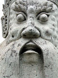 Looking his eyes !. Detail of an antique asian sculpture royalty free stock photography
