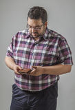 Looking at his wallet Stock Photography