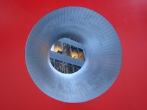 Looking through the hole in the Red Cube. Abstract view of office buildings taken through the red cube sculpture on Broadway in the New York Financial District Royalty Free Stock Photo