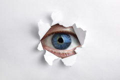 Looking through a hole in white paper Royalty Free Stock Photos