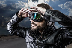 Looking at the horizon biker with black leather Royalty Free Stock Photo