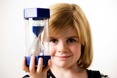 Looking at hourglass Royalty Free Stock Images