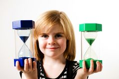 Looking at hourglasses Stock Image