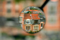 Looking for a house. House or Building in a Magnifying Glass royalty free stock image