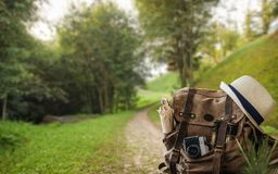 Looking image of travelling concept, essential vacation items. Background of mountain stock image