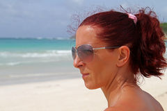 Looking at the infinite waves. Fit redhead mature woman looking at the sea on the Caribbean Royalty Free Stock Photography