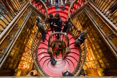 Looking inside Lello Bookstore, in Porto, Portugal. PORTO, PORTUGAL - FEBRUARY 27, 2017: Looking the stairs inside Lello Bookstore, famous book shop in Porto royalty free stock images