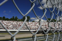 Looking from the inside out. Fans in the stands at New Hampshire International Raceway Royalty Free Stock Photo