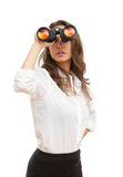 Looking for a job?. Portrait of fashionable young brunette woman searching employment with binoculars Stock Photo