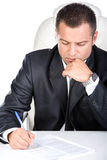 Looking for a job. Young unemployed man is writing summary. He is looking for a job stock photos