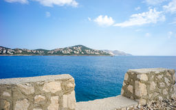 Looking at Kas Peninula, Turkey, across Aegean Sea from Route D4. In between dark blue Aegean Sea and cloudy sky lies Kas Peninsula, where many residential Royalty Free Stock Images