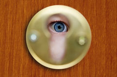 Looking through a keyhole Stock Photo