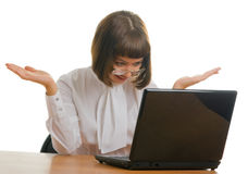 Looking at a laptop. Pretty secretary vigorously reacting to something looking at a laptop Stock Photos