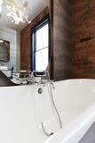 Looking into large white freestanding vintage bath tub Stock Photo