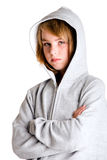 Looking little angry in my hooded sweater. Girl in hooded sweater looking a little angry at you. Made in a studio environment on white background with Canon 5D royalty free stock photo