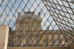 Looking at the Louvre from inside the glass pyramid Royalty Free Stock Photography