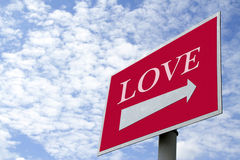 Looking for Love. A road sign or signboard with an arrow leading the way to LOVE, clipping paths for arrow and board Stock Photos