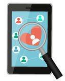Looking for love online. Tablet with a magnifying glass and heart. Vector illustration Stock Image