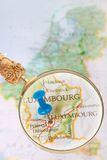 Looking in on Luxembourg. Blue tack on map of Benelux with magnifying glass looking in on Luxembourg, Europe Stock Photo