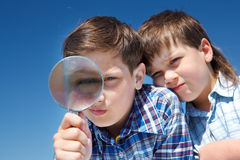 Looking through magnifying glass Royalty Free Stock Images