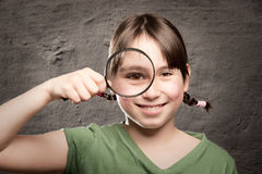 Looking through magnifying glass Royalty Free Stock Photography