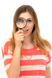 Looking through a magnifying glass Stock Images