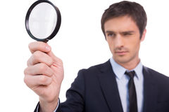 Looking through magnifying glass. Royalty Free Stock Images
