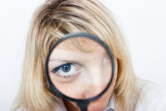 Looking through a magnifying glass Stock Photos